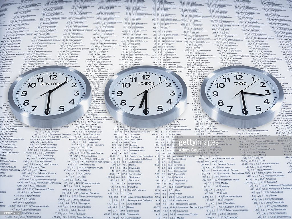 Time zone clocks on list of share prices : ストックフォト