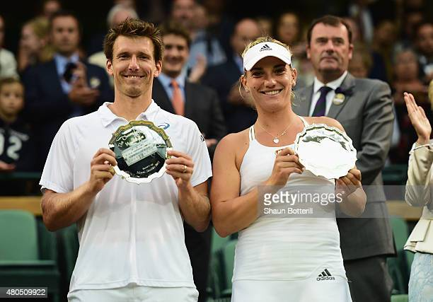 Timea Babos of Hungary and Alexander Peya of Austria celebrate with the Runner Up plates after losing the Final Of The Mixed Doubles against Leander...