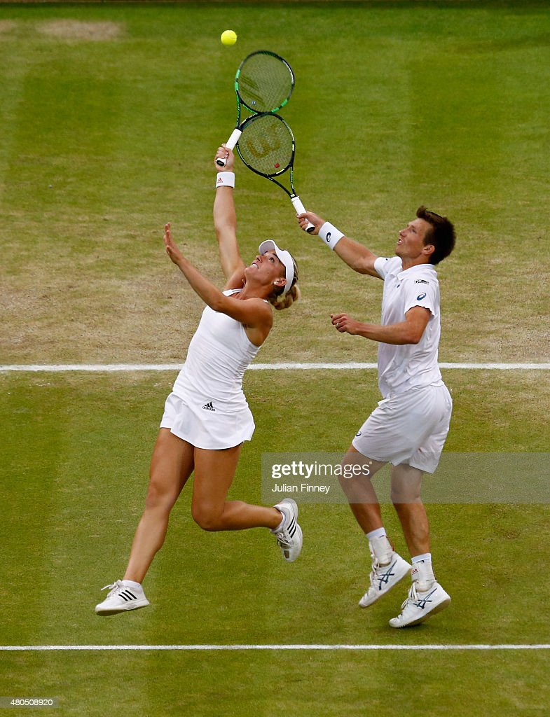 Timea Babos of Hungary and Alexander Peya of Austria in action in the Final Of The Mixed Doubles against Leander Paes of India and Martina Hingis of Switzerland on day thirteen of the Wimbledon Lawn Tennis Championships at the All England Lawn Tennis and Croquet Club on July 12, 2015 in London, England.