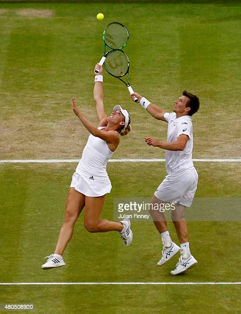 Timea Babos of Hungary and Alexander Peya of Austria in action in the Final Of The Mixed Doubles against Leander Paes of India and Martina Hingis of...