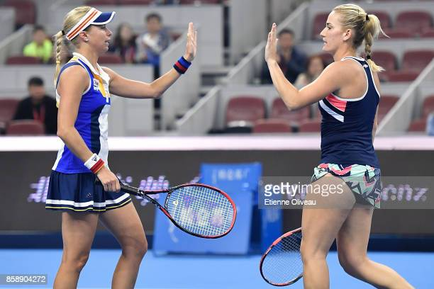 Timea Babos of Hungary and Andrea Hlavackova of Czech Republic check hands during their Women's doubles final match against YungJan Chan of Chinese...
