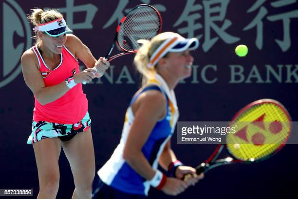 Timea Babos of Hungary and Andrea Hlavackova of the Czech Republic return a shot against Sloane Stephens of the USA and Heather Watson of Great...