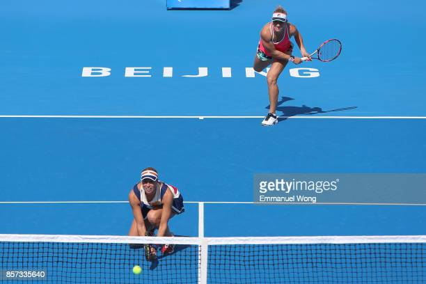 Timea Babos of Hungary and Andrea Hlavackova of the Czech Republic serve against Sloane Stephens of the USA and Heather Watson of Great Britain on...