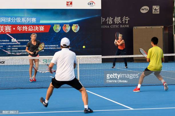 Timea Babos of Hungary and Andrea Hlavackova of the Czech Republic play tennis during the CRT Clinic on day seven of the 2017 China Open at the China...