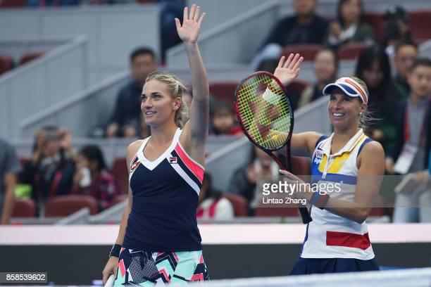 Timea Babos of Hungary and Andrea Hlavackova of the Czech Republic celebrate their victory over Ekaterina Makarova and Elena Vesnina of Russia during...