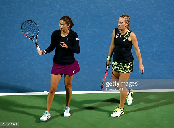 Timea Babos of Hungary and Julia Goerges of Germany in action against Caroline Garcia of France and Kristina Mladenovic of France during their...