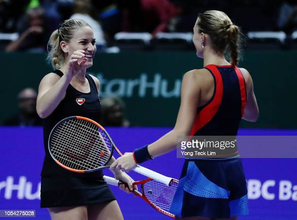 Timea Babos of Hungary and Kristina Mladenovic of France celebrate match point over Ashleigh Barty of Australia and CoCo Vandeweghe of the United...