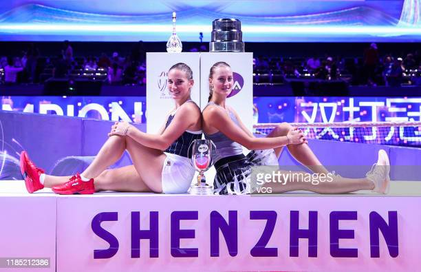 Timea Babos of Hungary and Kristina Mladenovic of France celebrate with the trophy after winning their Women's Doubles final match against SuWei...