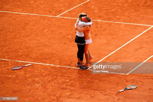 Timea Babos of Hungary and Kristina Mladenovic of France celebrate championship point during their Women's Doubles Final against Desirae Krawczyk of...