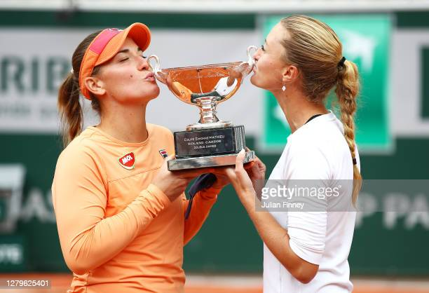 Timea Babos of Hungary and Kristina Mladenovic of France kiss the winners trophy following victory in their Women's Doubles Final against Desirae...