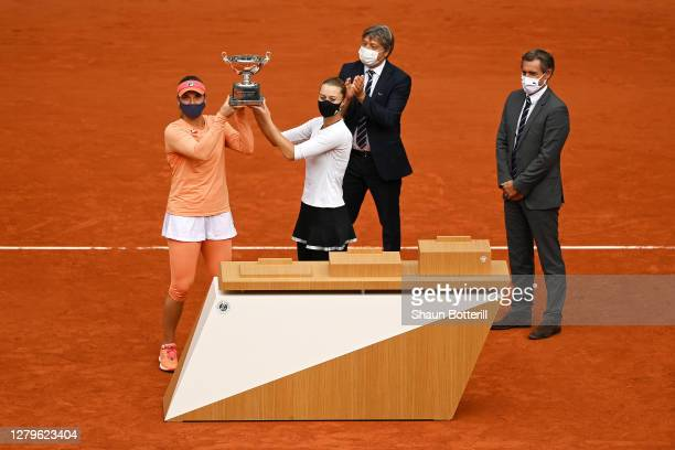 Timea Babos of Hungary and Kristina Mladenovic of France lift the winners trophy following their victory in the Women's Doubles Final against Desirae...