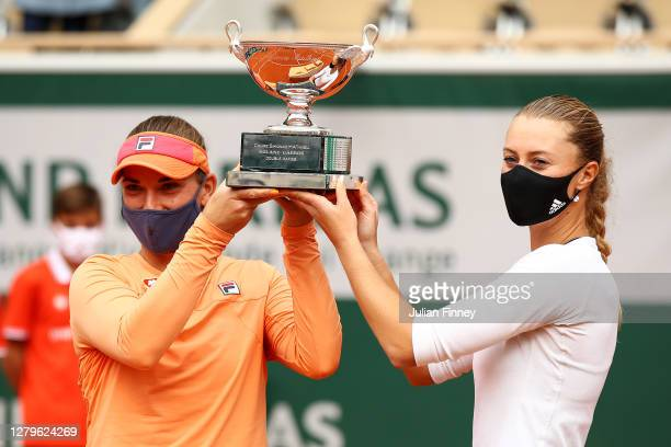 Timea Babos of Hungary and Kristina Mladenovic of France lift the winners trophy following victory in their Women's Doubles Final against Desirae...