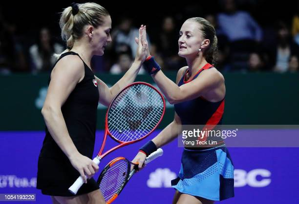 Timea Babos of Hungary and Kristina Mladenovic of France play Ashleigh Barty of Australia and CoCo Vandeweghe of the United States in the Women's...
