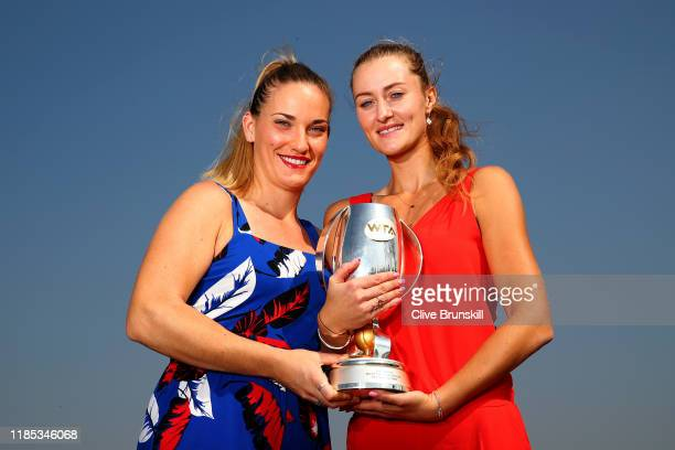 Timea Babos of Hungary and Kristina Mladenovic of France pose for a photo with the Martina Navratilova trophy following their victory in the Women's...