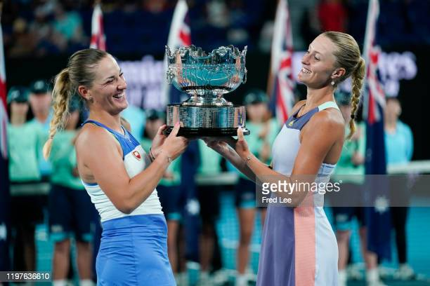 Timea Babos of Hungary and Kristina Mladenovic of France pose with the championship trophy after winning their Womens Doubles Final match against...