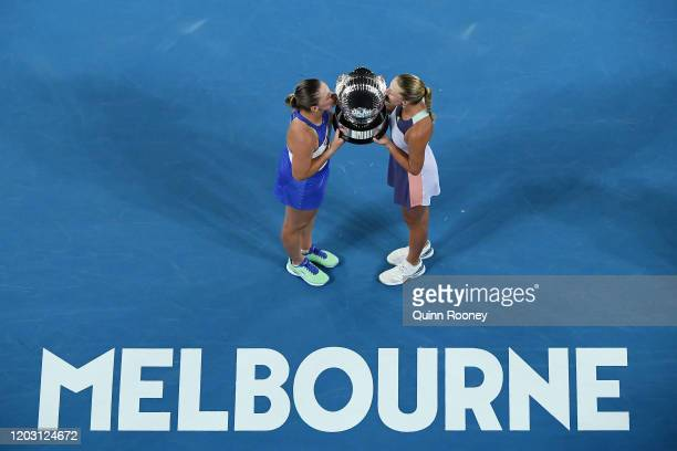 Timea Babos of Hungary and Kristina Mladenovic of France pose with the championship trophy after winning their Women's Doubles Final match against...