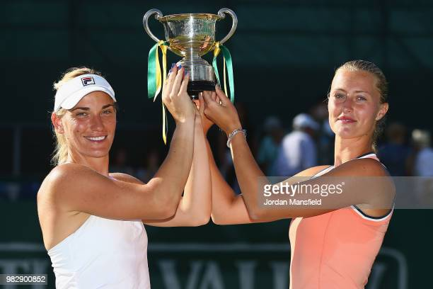 Timea Babos of Hungary and Kristina Mladenovic of France pose with the Trophy after their victory during their doubles Final match against Elise...