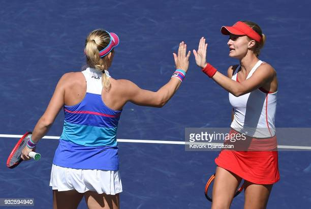 Timea Babos of Hungary and Kristina Mladenovic of France celebrateafer winning a game against Russian doubles partners Ekaterina Makarova and Elena...