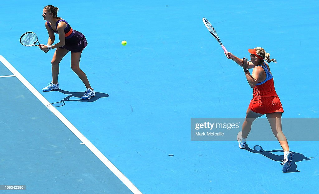 Timea Babos of Hungary and Mandy Minella of Luxembourg in action in their doubles final match against Garbine Muguruza and Maria-Teresa Torro-Flor of Spain during day nine of the Hobart International at Domain Tennis Centre on January 12, 2013 in Hobart, Australia.