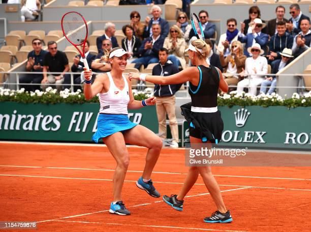 Timea Babos of Hungary and partner Kristina Mladenovic of France celebrate match point during the ladies doubles final against Yingying Duan of China...