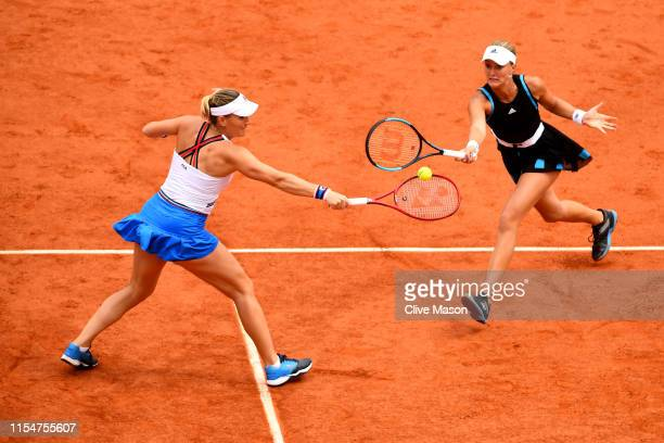 Timea Babos of Hungary and partner Kristina Mladenovic of France return the ball during the ladies doubles final against Yingying Duan of China and...