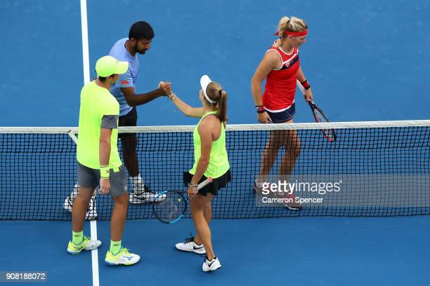 Timea Babos of Hungary and Rohan Bopanna of India are congratulated by Ellen Perez of Australia and Andrew Whittington of Australia after winning...