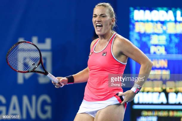 Timea Babos of Hungary celebrates a point during the match against Magda Linette of Poland during Day 3 of 2018 WTA Shenzhen Open at Longgang...
