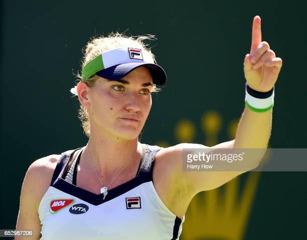 Timea Babos of Hungary challenges a call in her loss to Elena Vesnina of Russia during the BNP Paribas Open at Indian Wells Tennis Garden on March 13...