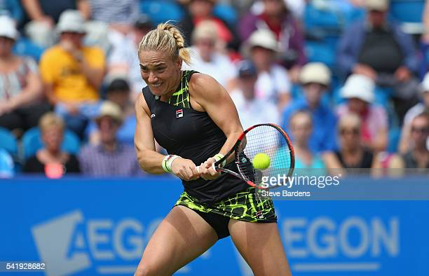 Timea Babos of Hungary plays a backhand during her women's singles match against Petra Kvitova of Czech Republic on day three of the WTA Aegon...