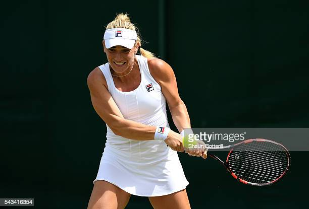 Timea Babos of Hungary plays a backhand during the LadiesSingles first round match against Katie Swan of Great Britain on day two of the Wimbledon...