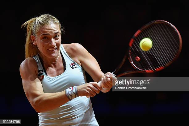 Timea Babos of Hungary plays a backhand in her match against Sabine Lisicki of Germany during Day 1 of the Porsche Tennis Grand Prix at PorscheArena...