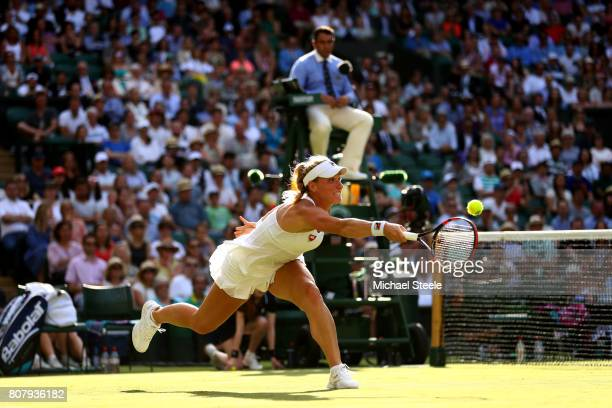 Timea Babos of Hungary plays a forehand during the Ladies Singles first round match against Caroline Wozniacki of Denmark on day two of the Wimbledon...