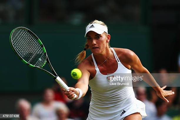 Timea Babos of Hungary plays a forehand in her Ladies Singles Second Round match against Serena Williams of the United States during day three of the...