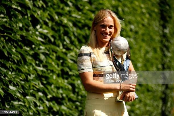 Timea Babos of Hungary poses with the WTA World No1 Doubles trophy on day eight of the Wimbledon Lawn Tennis Championships at All England Lawn Tennis...