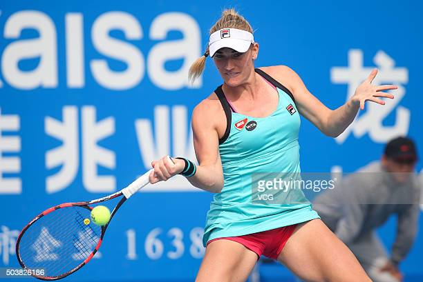 Timea Babos of Hungary returns a shot against Eugenie Bouchard of Canada in quarter finals match during Day five of 2016 WTA Shenzhen Open at...