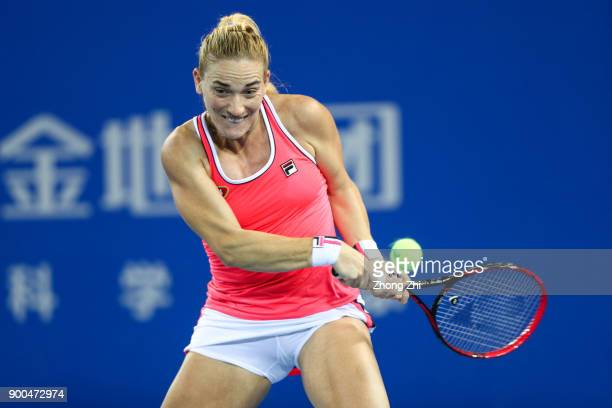Timea Babos of Hungary returns a shot during the match against Magda Linette of Poland during Day 3 of 2018 WTA Shenzhen Open at Longgang...