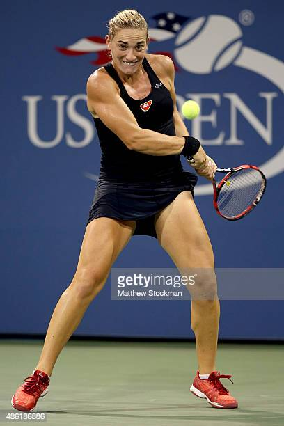 Timea Babos of Hungary returns a shot to Samantha Stosur of Australia during their Women's Singles First Round match on Day Two of the 2015 US Open...