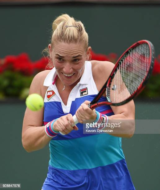 Timea Babos of Hungary returns against Belinda Bencic of Switzerland during Day 3 of the BNP Paribas Open on March 7 2018 in Indian Wells California