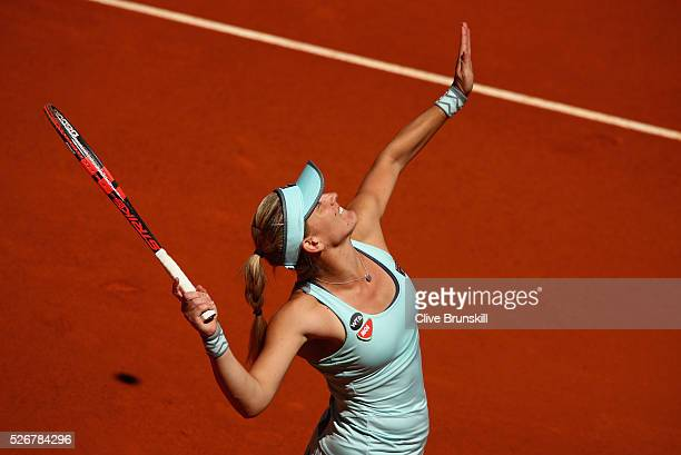 Timea Babos of Hungary serves against Carla Suarez Navarro of Spain in their first round match during day two of the Mutua Madrid Open tennis...