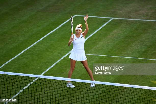 Timea Bacsinszky of Switzerland acknowledges the crowd as she celebrates victory after her during the Ladies Singles first round match against Monica...