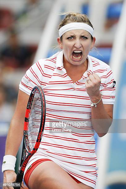 Timea Bacsinszky of Switzerland celebrates a point during the against Camila Giorgi of Italy during the day one of the 2015 China Open at the China...