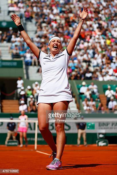 Timea Bacsinszky of Switzerland celebrates match point in her Women's quarter final match against Alison Van Uytvanck of Belgium on day eleven of the...