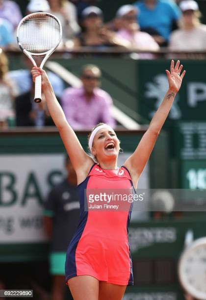 Timea Bacsinszky of Switzerland celebrates victory in her women's singles fourth round match against Venus Williams of the United States during day...