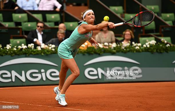 Timea Bacsinszky of Switzerland hits a backhand during the Ladies Singles second round match against Eugenie Bouchard of Canada on day five of the...