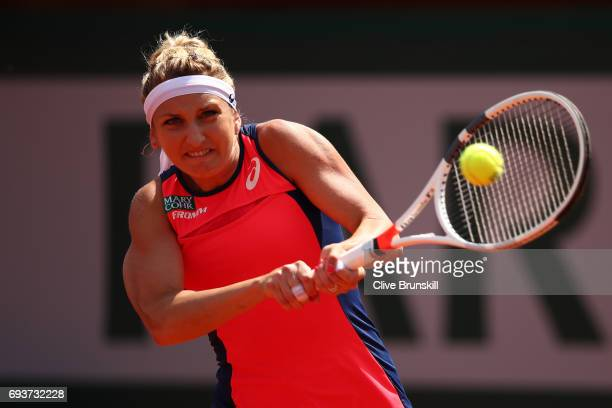 Timea Bacsinszky of Switzerland hits a backhand during the ladies semi final match against Jelena Ostapenko of Latvia on day twelve of the 2017...