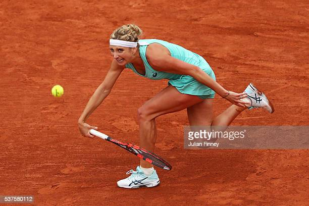 Timea Bacsinszky of Switzerland hits a forehand during the Ladies Singles quarter final match against Kiki Bertens of Netherlands on day twelve of...