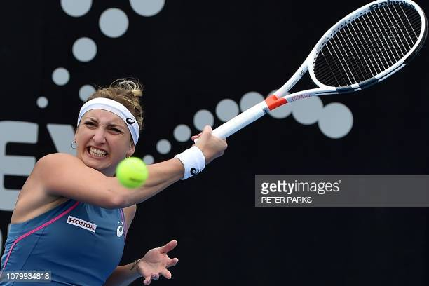 TOPSHOT Timea Bacsinszky of Switzerland hits a return against Aliaksandra Sasnovich of Belarus during their women's singles quarterfinal match at the...