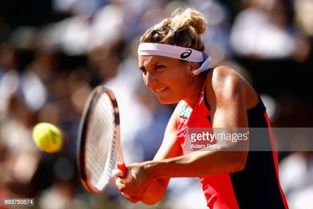 Timea Bacsinszky of Switzerland plays a backhand during the ladies singles semifinal match against Jelena Ostapenko of Latvia on day twelve of the...