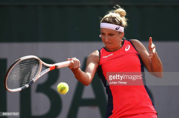 Timea Bacsinszky of Switzerland plays a forehand during the ladies singles second round match against Madison Brengle of The Unites States on day...
