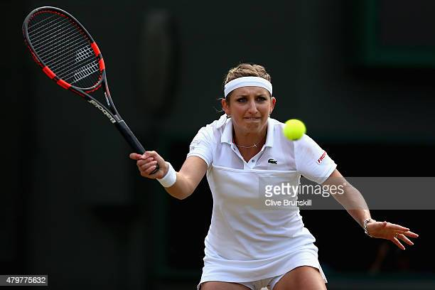 Timea Bacsinszky of Switzerland plays a forehand in her Ladies Singles Quarter Final match against Garbine Muguruza of Spain during day eight of the...